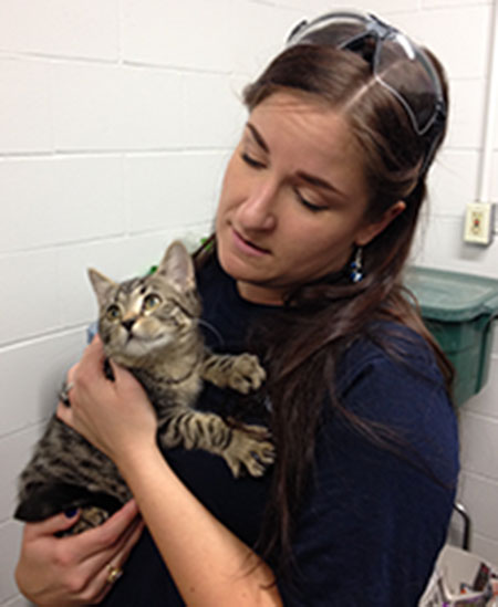 Kenai Spine staff with shelter animal